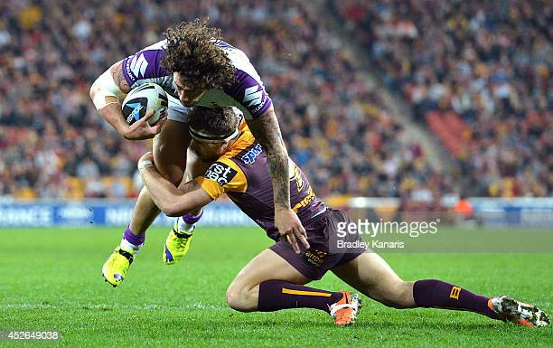 Kevin Proctor of the Storm is tackled during the round 20 NRL match between the Brisbane Broncos and the Melbourne Storm at Suncorp Stadium on July...