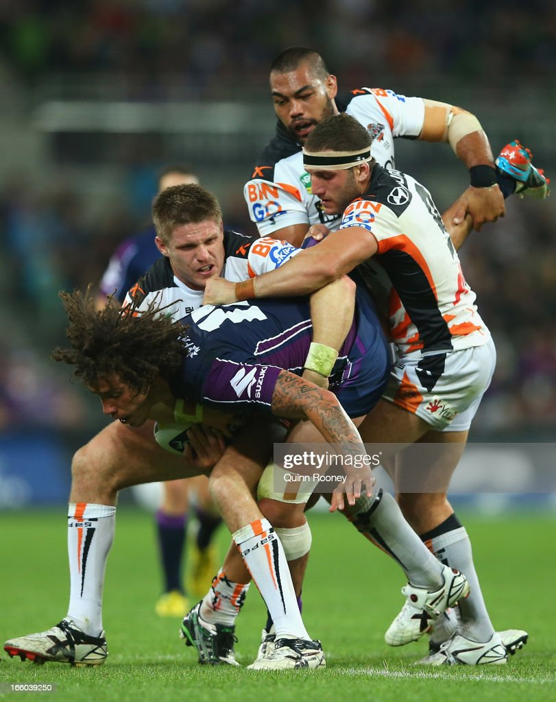 Kevin Proctor of the Storm is tackled during the round 5 NRL match between the Melbourne Storm and the Wests Tigers at AAMI Stadium on April 8, 2013 in Adelaide, Australia.