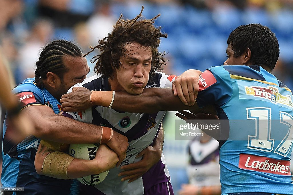Kevin Proctor of the Storm is tackled during the round nine NRL match between the Gold Coast Titans and the Melbourne Storm on May 1, 2016 in Gold Coast, Australia.