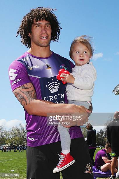 Kevin Proctor of the Storm is wished well by fans when walking off with his daughter during a Melbourne Storm NRL training session at Gosch's Paddock...