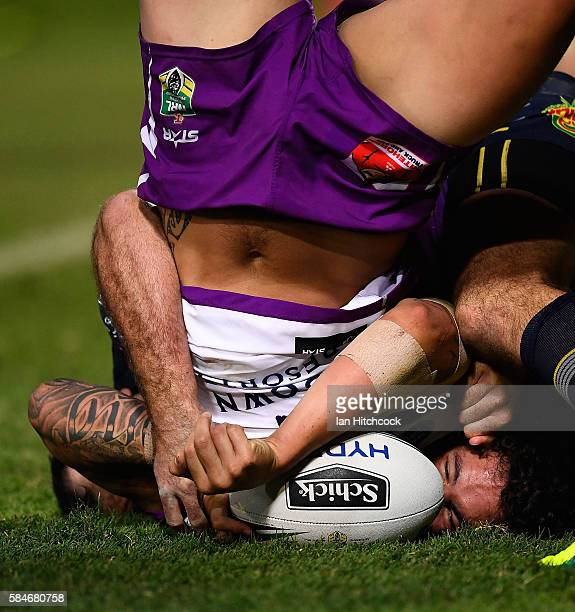 Kevin Proctor of the Storm scores a try during the round 21 NRL match between the North Queensland Cowboys and the Melbourne Storm at 1300SMILES...