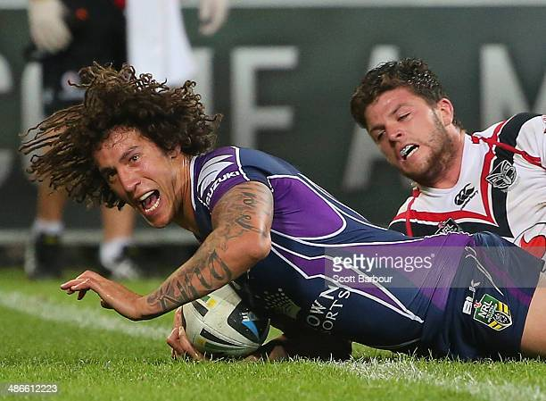 Kevin Proctor of the Storm scores a try during the round 8 NRL match between the Melbourne Storm and the New Zealand Warriors at AAMI Park on April...