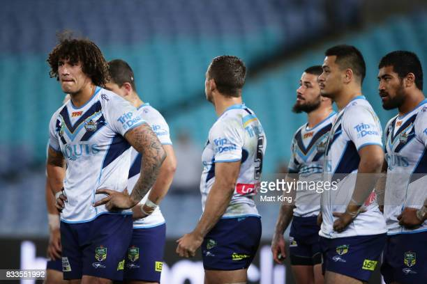 Kevin Proctor of the Titans and team mates look dejected after an Eels try during the round 24 NRL match between the Parramatta Eels and the Gold...