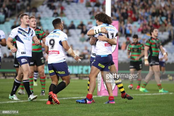 Kevin Proctor of the Titans celebrates with his team mates after scoring a try during the round 15 NRL match between the South Sydney Rabbitohs and...