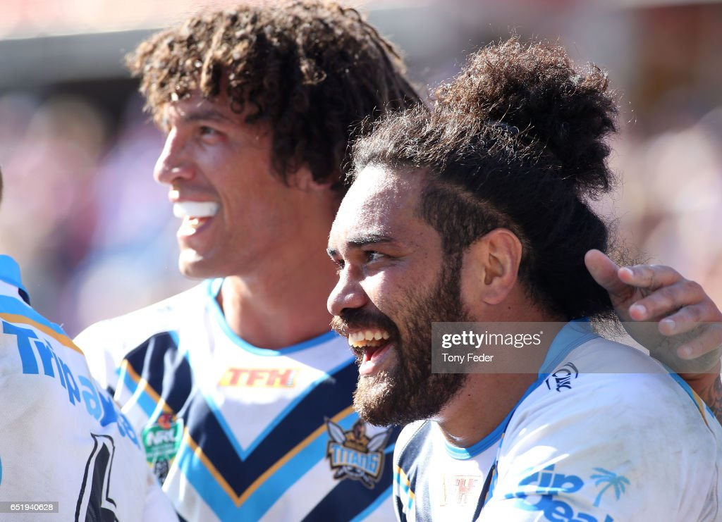 Kevin Proctor of the Titans (L) celebrates with team mate Konrad Hurrell (R) during the round two NRL match between the Newcastle Knights and the Gold Coast Titans at McDonald Jones Stadium on March 11, 2017 in Newcastle, Australia.