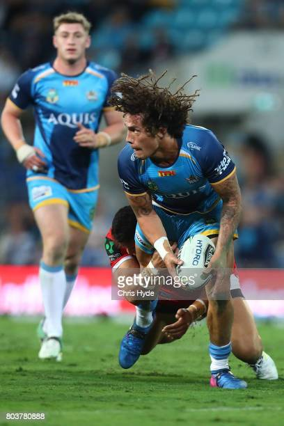 Kevin Proctor of the Titans is tackled during the round 17 NRL match between the Gold Coast Titans and the St George Illawarra Dragons at Cbus Super...
