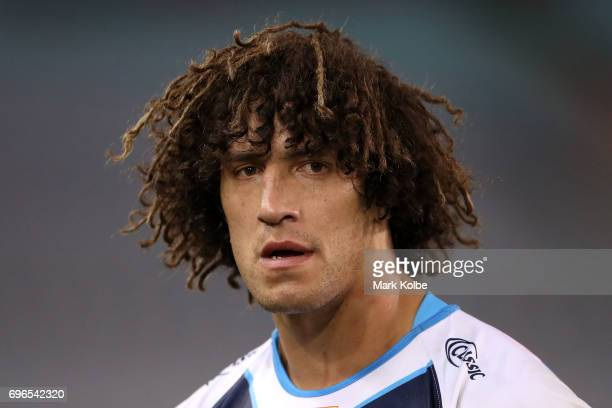 Kevin Proctor of the Titans looks dejected after defeat during the round 15 NRL match between the South Sydney Rabbitohs and the Gold Coast Titans at...