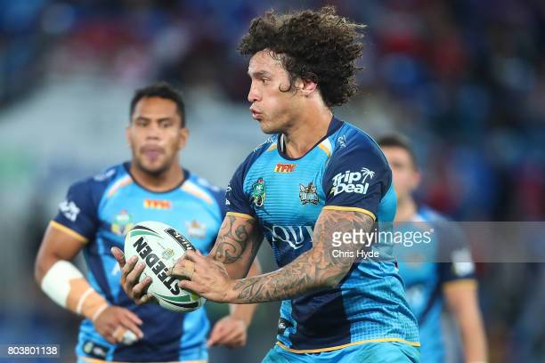 Kevin Proctor of the Titans runs the ball during the round 17 NRL match between the Gold Coast Titans and the St George Illawarra Dragons at Cbus...