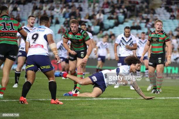 Kevin Proctor of the Titans scores a try during the round 15 NRL match between the South Sydney Rabbitohs and the Gold Coast Titans at ANZ Stadium on...