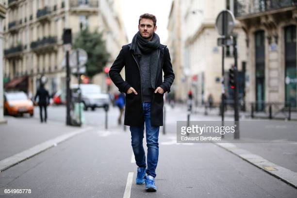 Kevin Ragonneau fashion and life style blogger wears New Balance blue sneakers shoes Zara blue denim jeans a Gap pull over a Carnet de Vol jacket and...