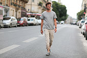 Kevin Ragonneau is wearing a Zara gray tshirt Zara pants Celio blue shoes and a Kapten and Son watch during a street style session on July 24 2016 in...