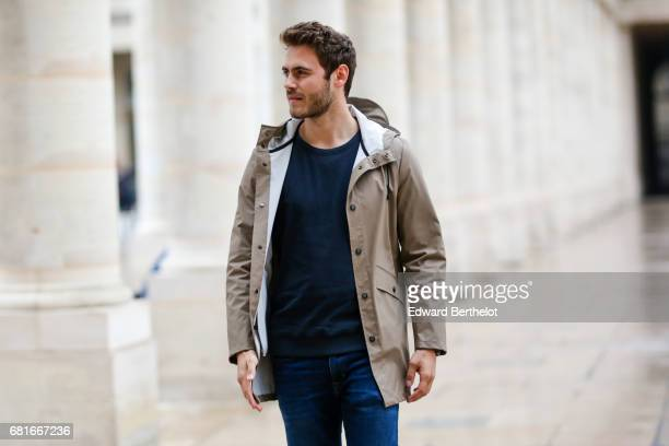 Kevin Ragonneau life style blogger wears a Kway rain coat Calvin Klein jeans Fila sneakers shoes an American Vintage blue pull over a Kronaby watch...