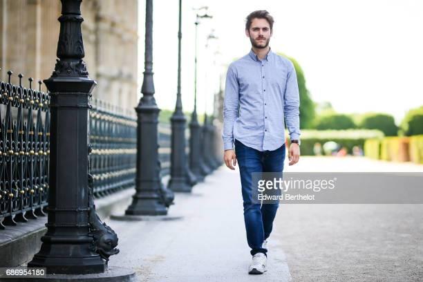 Kevin Ragonneau life style blogger wears a Pull Bear jacket a Zara blue shirt Calvin Klein jeans Fila sneakers shoes and a Daniel Wellington watch on...