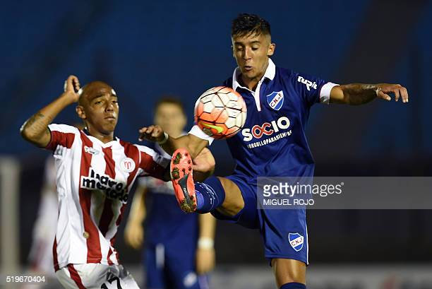 Kevin Ramirez of Uruguay's Nacional vies for the ball with Leonardo Rodriguez of Uruguay's River Plate during their Libertadores Cup football match...