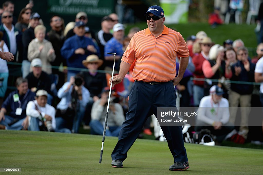 Kevin reacts on the 18th hole during the final round of the Waste Management Phoenix Open at TPC Scottsdale on February 2, 2014 in Scottsdale, Arizona.