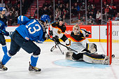 Kevin Reich of Team Germany stops a shot by Jesse Puljujarvi of Team Finland in a preliminary round game during the 2015 IIHF World Junior Hockey...