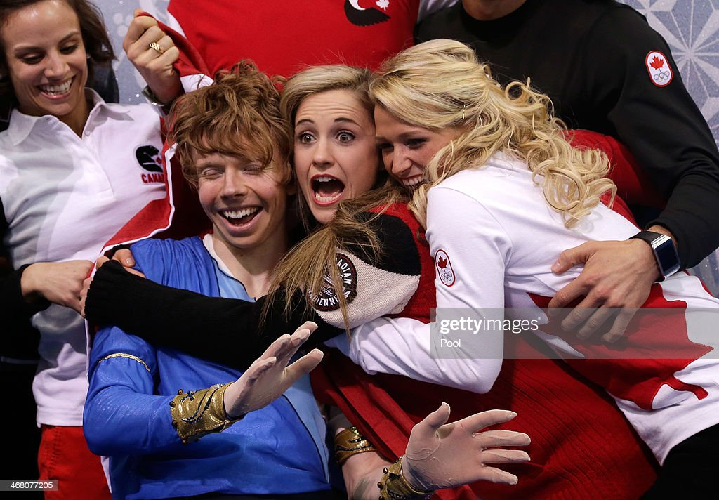 <a gi-track='captionPersonalityLinkClicked' href=/galleries/search?phrase=Kevin+Reynolds&family=editorial&specificpeople=5578771 ng-click='$event.stopPropagation()'>Kevin Reynolds</a> of Canada reacts with teammates and coaches after receiving his score in the Men's Figure Skating Men's Free Skate during day two of the Sochi 2014 Winter Olympics at Iceberg Skating Palace onon February 9, 2014 in Sochi, Russia.