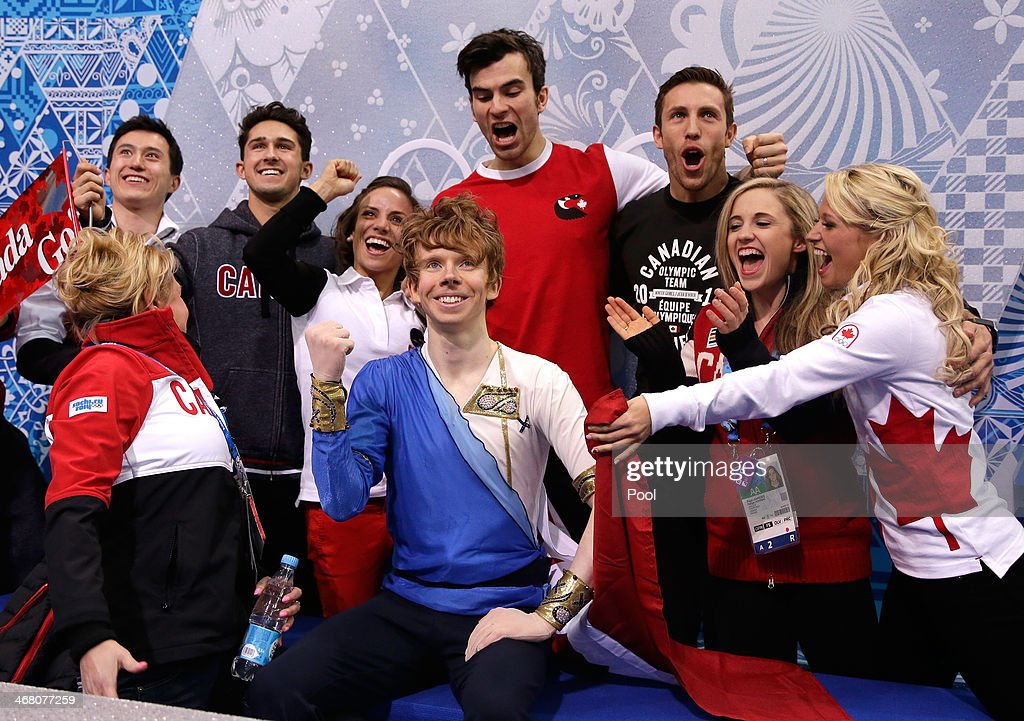 <a gi-track='captionPersonalityLinkClicked' href=/galleries/search?phrase=Kevin+Reynolds&family=editorial&specificpeople=5578771 ng-click='$event.stopPropagation()'>Kevin Reynolds</a> of Canada reacts with teammates and coaches while waiting for his score in the Men's Figure Skating Men's Free Skate during day two of the Sochi 2014 Winter Olympics at Iceberg Skating Palace onon February 9, 2014 in Sochi, Russia.