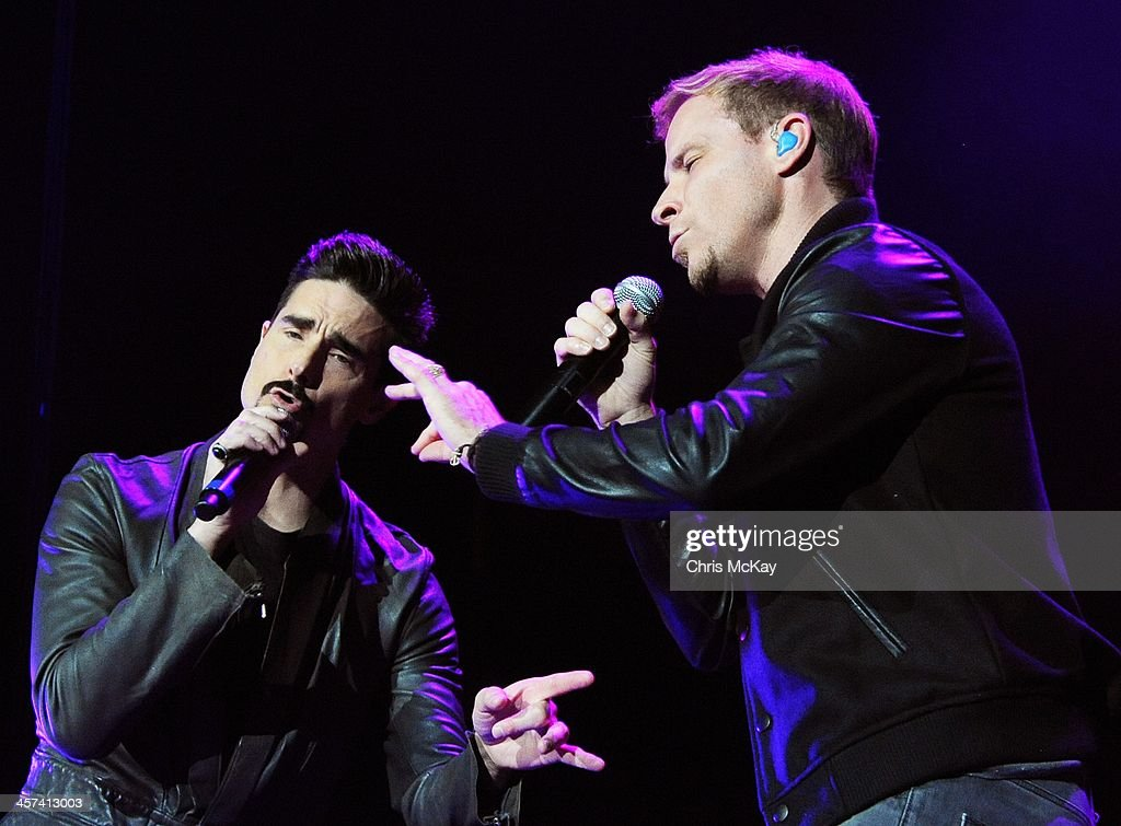 Kevin Richardson and Brian Littrell of Backstreet Boys perform during the 2013 Star 94 Jingle Jam at Arena at Gwinnett Center on December 16, 2013 in Duluth, Georgia.