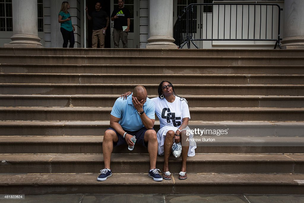 Kevin Richardson (L), one of the five men wrongfully convicted of raping a woman in Central Park in 1989, takes time to cool down with his sister during a press conference on city hall's steps after it was announced that the men, known as the 'Central Park Five,' had settled with New York City for approximately $40 million dollars on June 27, 2014 in New York City. All five men spent time in jail, until their convictions were overturned in 2002 after being proven innocent.