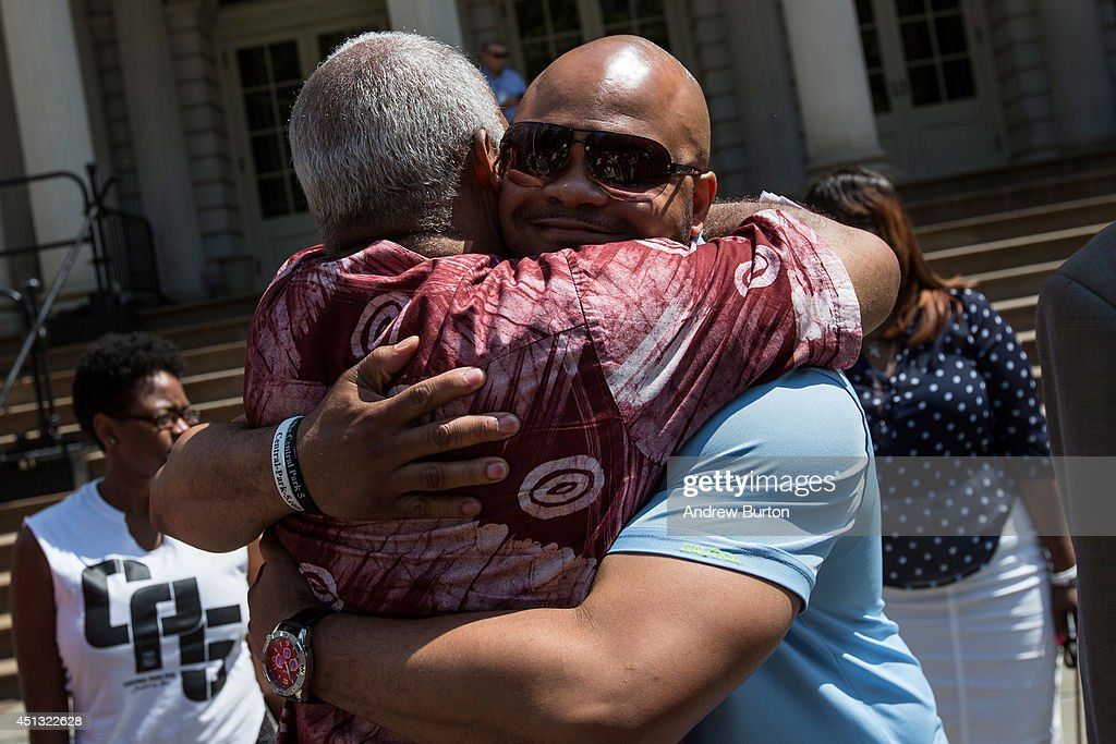 Kevin Richardson (R), one of the five men wrongfully convicted of raping a woman in Central Park in 1989, hugs a supporter before a press conference on city hall's steps after it was announced that the men, known as the 'Central Park Five,' had settled with New York City for approximately $40 million dollars on June 27, 2014 in New York City. All five men spent time in jail, until their convictions were overturned in 2002 after being proven innocent.