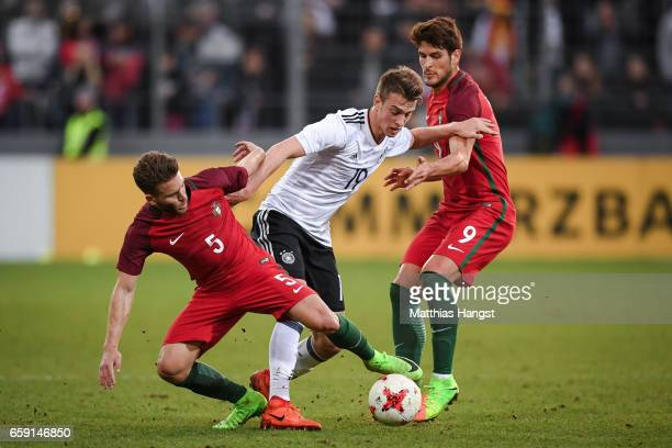 Kevin Rodrigues of Portugal Janik Haberer of Germany and Gonzalo Paciencia of Portugal battle for the ball during the U21 International Friendly...