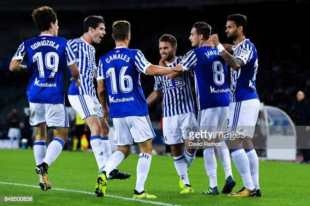 Kevin Rodrigues of Real Sociedad de Futbol celebrates with his team mates after scoring his team's first goal during the La Liga match between Real...