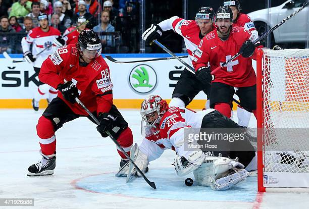 Kevin Romy of Switzerland fails to score over Bernhard Starkbaum goaltender of Austria during the IIHF World Championship group A match between...
