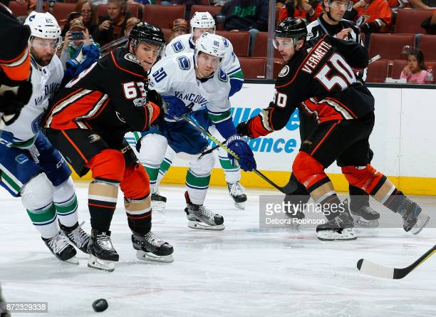 Kevin Roy and Antoine Vermette of the Anaheim Ducks battle for the puck against Markus Granlund and Sam Gagner of the Vancouver Canucks during the...