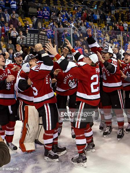 Kevin Roy and teammate Tanner Pond of the Northeastern Huskies celebrates as the Huskies win the Hockey East Championship against the Massachusetts...