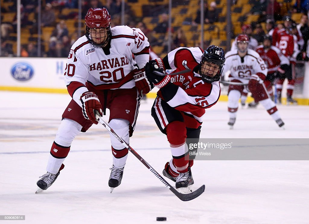 Kevin Roy #15 of Northeastern University and Adam Baughman #20 of Harvard University fight for the puck during the third period of the Beanpot Tournament consolation game at TD Garden on February 8, 2016 in Boston, Massachusetts.