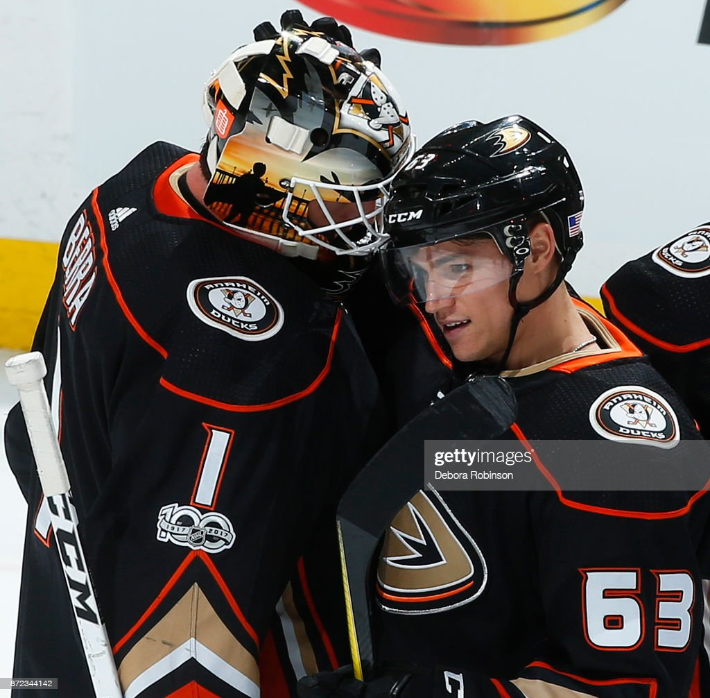 Kevin Roy #63 of the Anaheim Ducks congratulates Reto Berra #1 after a 4-1 win against the Vancouver Canucks on November 9, 2017 at Honda Center in Anaheim, California.