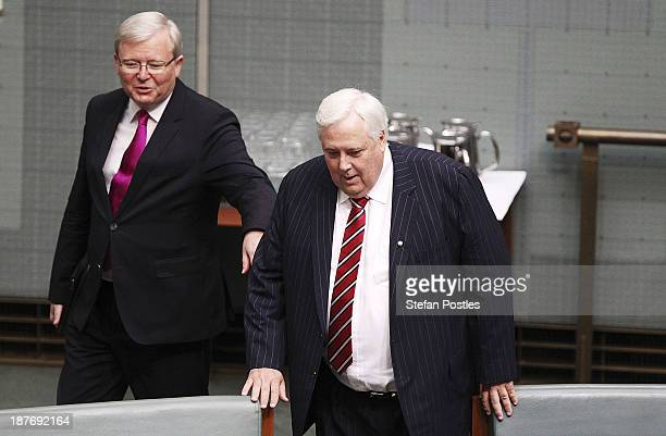 Kevin Rudd and Clive Palmer arrive at a swearing in ceremony in the House of Representatives chamber at Parliament House on November 12 2013 in...