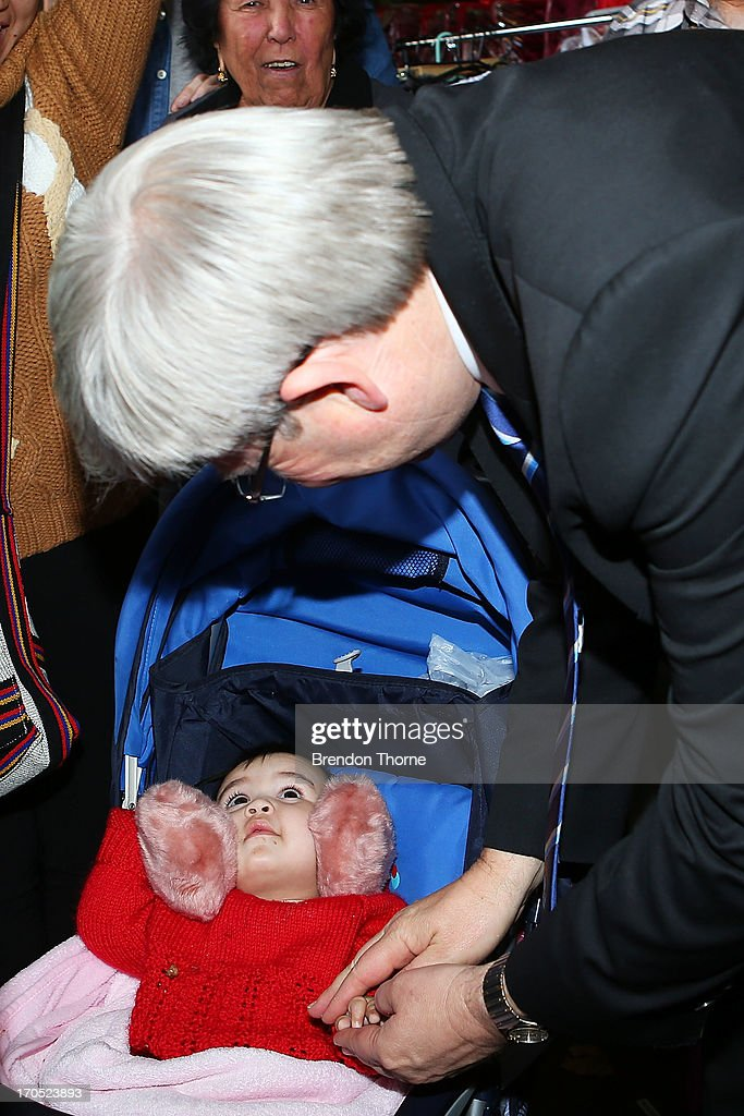 <a gi-track='captionPersonalityLinkClicked' href=/galleries/search?phrase=Kevin+Rudd&family=editorial&specificpeople=707751 ng-click='$event.stopPropagation()'>Kevin Rudd</a> greets a small child in the suburb of Fairfield on June 14, 2013 in Sydney, Australia. Former Prime Minister <a gi-track='captionPersonalityLinkClicked' href=/galleries/search?phrase=Kevin+Rudd&family=editorial&specificpeople=707751 ng-click='$event.stopPropagation()'>Kevin Rudd</a> today campaigned for Labor MPs contensting key seats in Drummoyne and McMahon, amid rumours he may bid to regain Labor leadership.