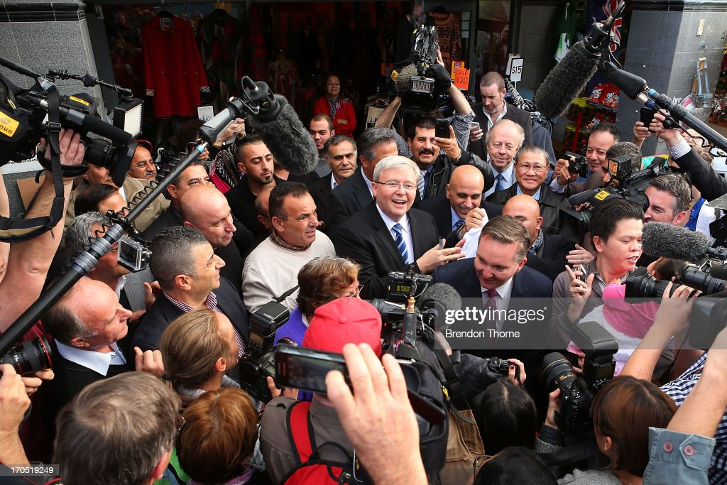 Kevin Rudd is mobbed by cheering locals in the suburb of Fairfield on June 14, 2013 in Sydney, Australia. Former Prime Minister Kevin Rudd today campaigned for Labor MPs contensting key seats in Drummoyne and McMahon, amid rumours he may bid to regain Labor leadership.