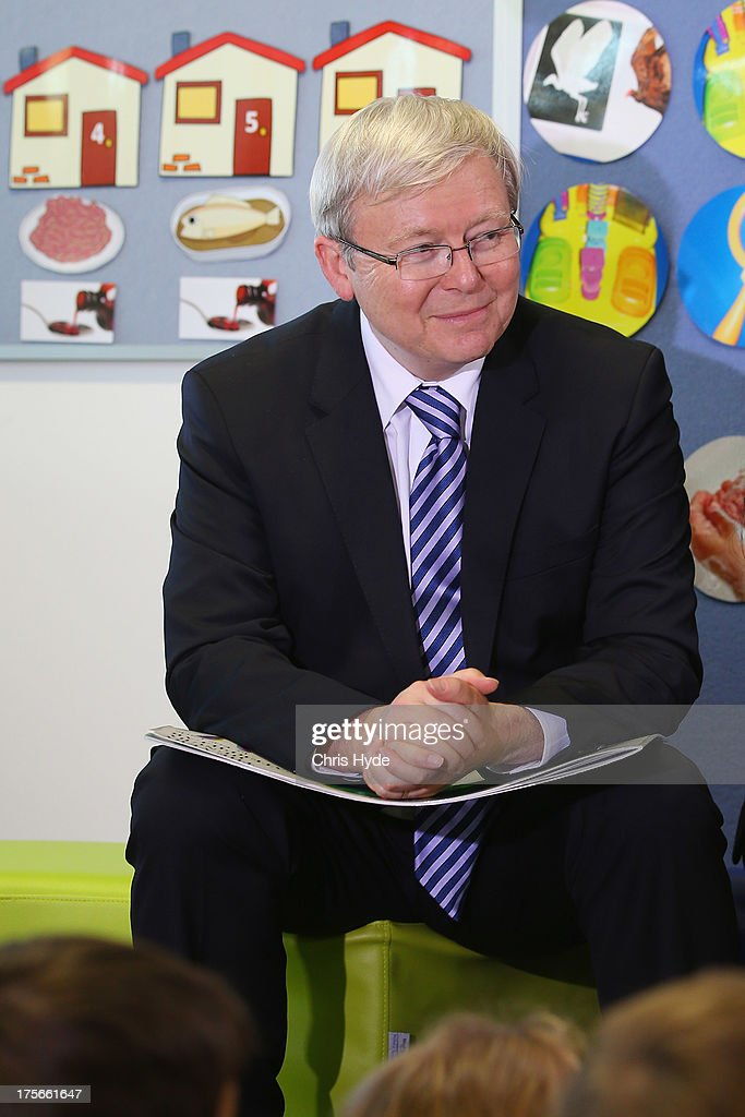 PM Kevin Rudd reads to children during a visit to Brisbane Adventist College on August 6, 2013 in Brisbane, Australia. On day two of the 2013 election campaign Rudd made a funding announcement for transport in Brisbane, and addressed Rupert Murdoch's comments on the National Broadband Network.