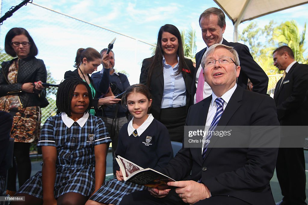PM Kevin Rudd reads to children during a visit to Brisbane Adventist College with Local member Laura Fraser Hardy and Minister for Education Bill Shorten on August 6, 2013 in Brisbane, Australia. On day two of the 2013 election campaign Rudd made a funding announcement for transport in Brisbane, and addressed Rupert Murdoch's comments on the National Broadband Network.