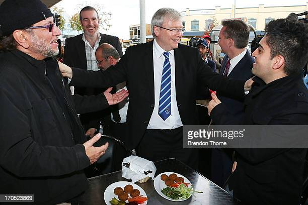 Kevin Rudd serves locals a plate of falafels in the suburb of Fairfield on June 14 2013 in Sydney Australia Former Prime Minister Kevin Rudd today...