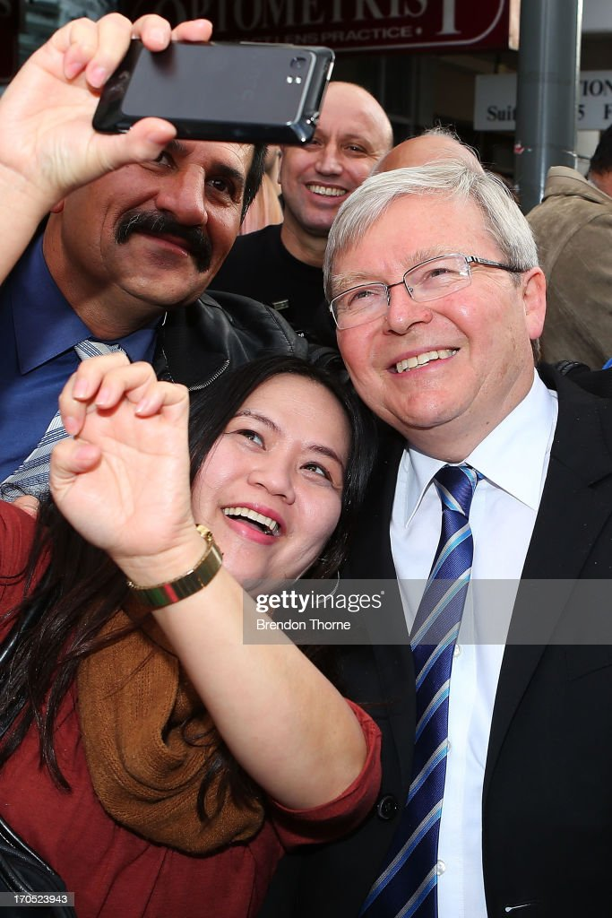 <a gi-track='captionPersonalityLinkClicked' href=/galleries/search?phrase=Kevin+Rudd&family=editorial&specificpeople=707751 ng-click='$event.stopPropagation()'>Kevin Rudd</a> shares a photo with locals in the suburb of Fairfield on June 14, 2013 in Sydney, Australia. Former Prime Minister <a gi-track='captionPersonalityLinkClicked' href=/galleries/search?phrase=Kevin+Rudd&family=editorial&specificpeople=707751 ng-click='$event.stopPropagation()'>Kevin Rudd</a> today campaigned for Labor MPs contensting key seats in Drummoyne and McMahon, amid rumours he may bid to regain Labor leadership.