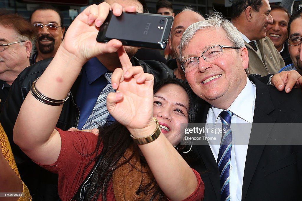 Kevin Rudd shares a photo with locals in the suburb of Fairfield on June 14, 2013 in Sydney, Australia. Former Prime Minister Kevin Rudd today campaigned for Labor MPs contensting key seats in Drummoyne and McMahon, amid rumours he may bid to regain Labor leadership.