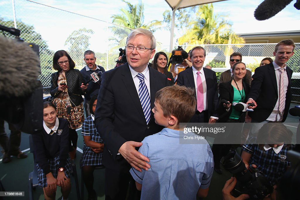 PM Kevin Rudd talks to children during a visit to Brisbane Adventist College with Local member Laura Fraser Hardy and Minister for Education Bill Shorten on August 6, 2013 in Brisbane, Australia. On day two of the 2013 election campaign Rudd made a funding announcement for transport in Brisbane, and addressed Rupert Murdoch's comments on the National Broadband Network.