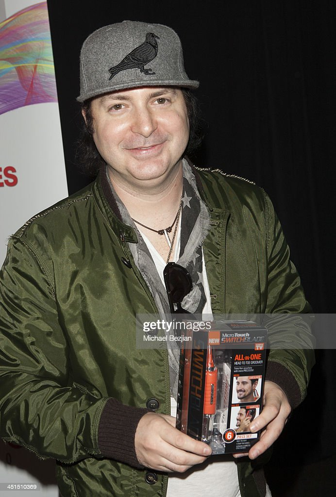 Kevin Rudolf attends Flips Audio Headphones Sponsors the Official Artist Gift Lounge Cumulus Radio Row At the American Music Awards Day 1 on November...