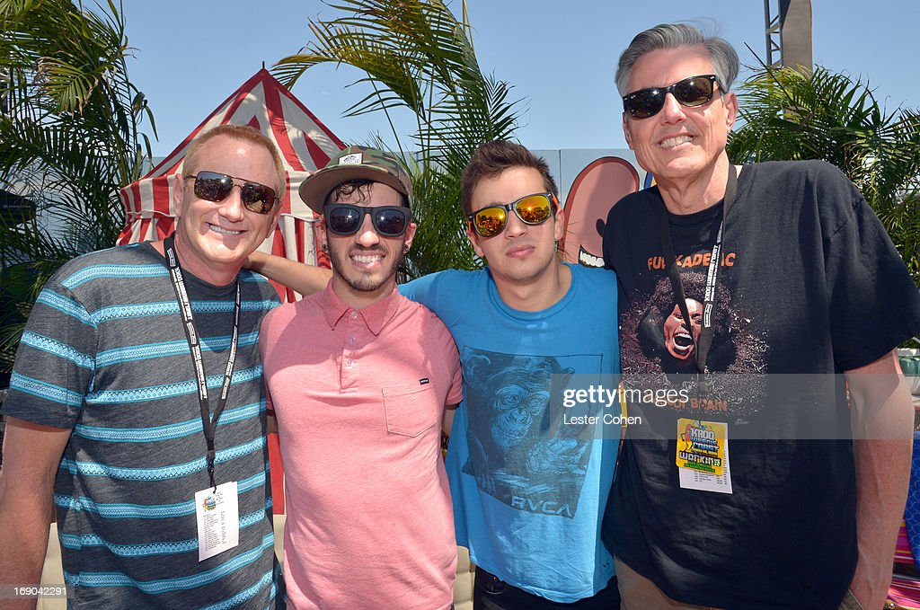 Kevin Ryder, Josh Dun and Tyler Joseph of 21 Pilots and Gene 'Bean' Baxter backstage during KROQ Weenie Roast Y Fiesta at Verizon Wireless Amphitheater on May 18, 2013 in Irvine, California.