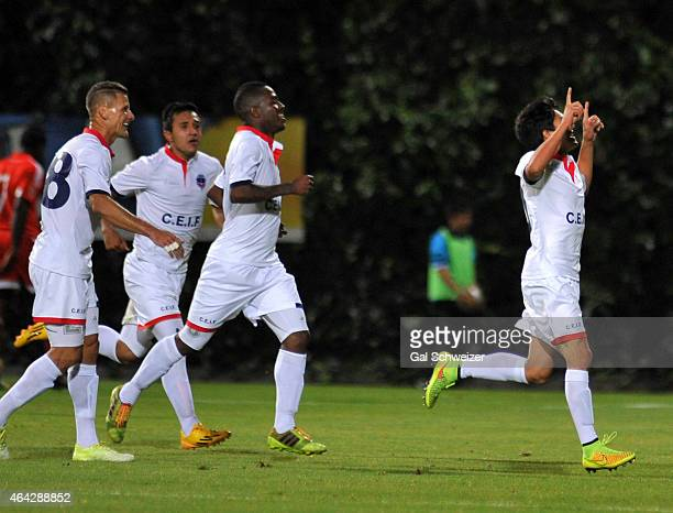 Kevin Salazar of Fortaleza celebrates with his teammates after scoring a goal during a match between Fortaleza and America de Cali as part of second...
