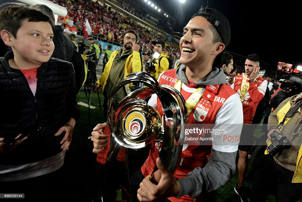 Kevin Salazar of Santa Fe holds the trophy to celebrate after winning a second leg final match between Santa Fe and Deportes Tolima as part of Liga Aguila II 2016 at El Campin Stadium on December 18, 2016 in Bogota, Colombia.