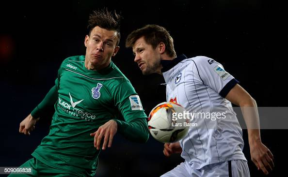 Kevin Scheidhauer of Duisburg is challenged by Julian Boerner of Bielefeld during the Second Bundesliga match between Arminia Bielefeld and MSV...