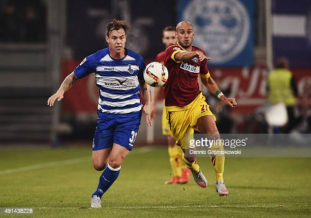 Kevin Scheidhauer of MSV Duisburg is chased by Daniel Brueckner of SC Paderborn during the Second Bundesliga match between MSV Duisburg and SC...