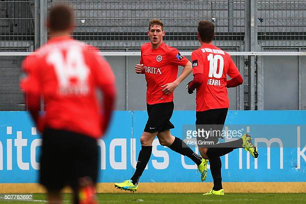 Kevin Schindler of Wehen Wiesbaden celebrates his team's first goal with team mates during the Third League match between SV Wehen Wiesbaden and...