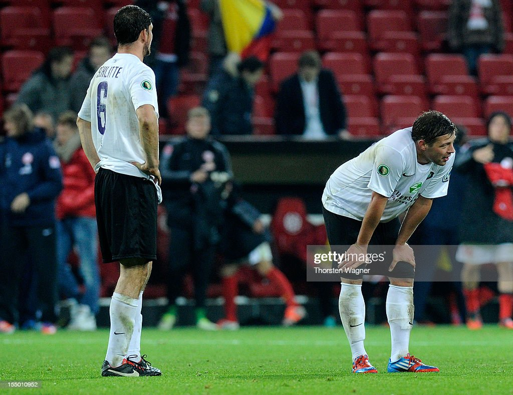 Kevin Schlitte (L) and Guido Kocer (R) of Aue looks dejected after loosing the DFB Cup second round match between FSV Mainz 05 and FC Erzgebirge Aue at Coface Arena on October 30, 2012 in Mainz, Germany.