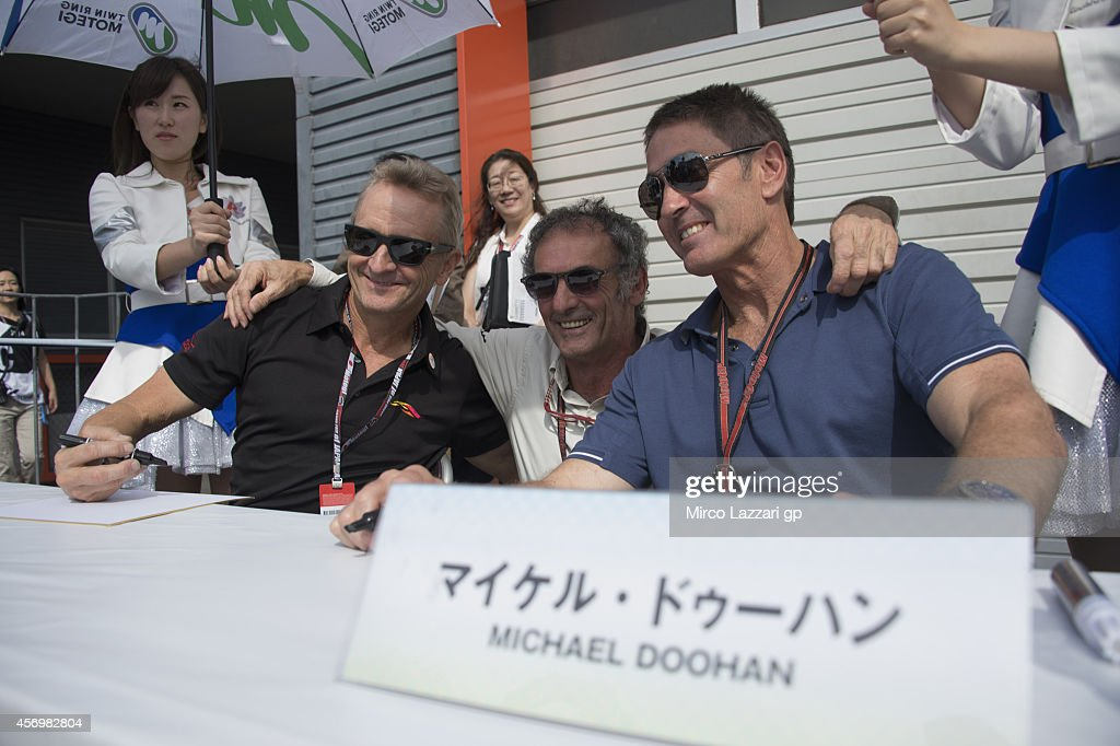 Kevin Schwantz of USA, Franco Uncini of Italy and Michael Doohan of Australia smile for fans during the MotoGP Of Japan - Free Practice at Twin Ring Motegi on October 10, 2014 in Motegi, Japan.